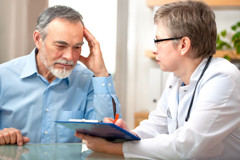 Doctor Listening to Patients Depression Symptoms